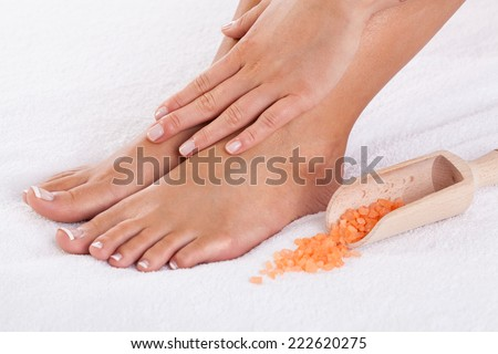 Close-up of well-cared  female hands and feet - stock photo