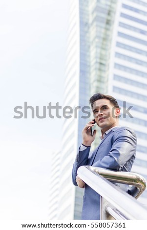 Close up of westerner business man make phone call