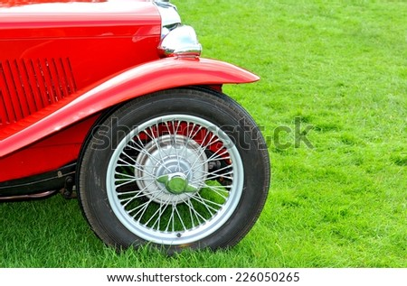 Close up of wheel of a red retro car - stock photo