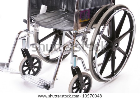 Close up of wheels on a wheelchair. - stock photo