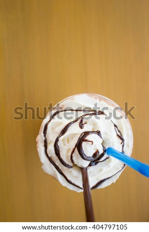 Close up of whipped cream topped with chocolate on Iced cocoa drink. - stock photo