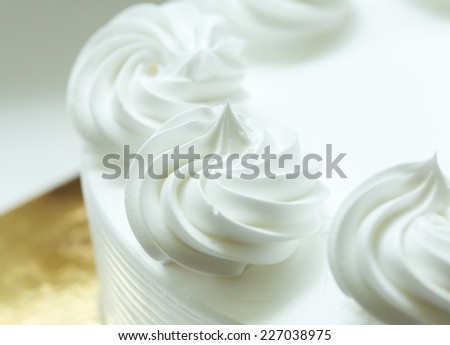Close up of whipping cream cake decoration. - stock photo