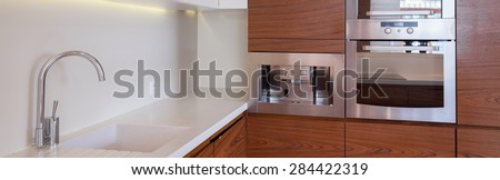 Close-up of white and brown luxury kitchen - stock photo