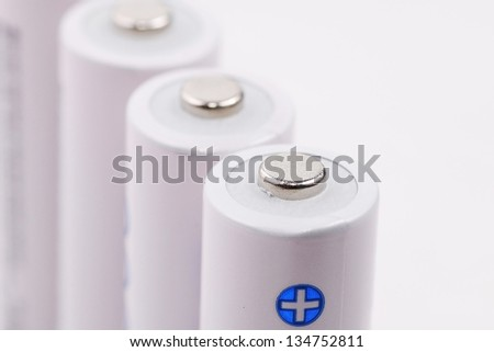 close-up of white cell batteries on isolated white background - stock photo