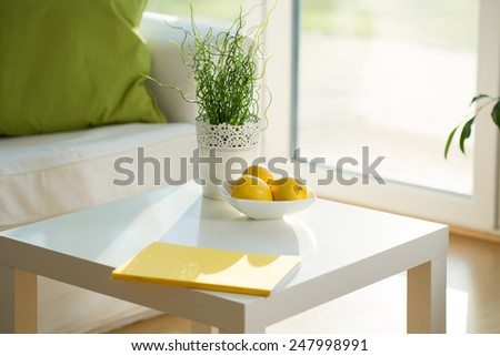 Close-up of white coffee table in lounge - stock photo