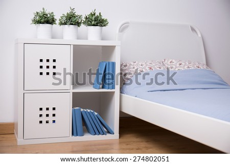 Close-up of white furniture in teen bedroom - stock photo