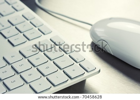 Close-up of White keyboard and mouse on metal background