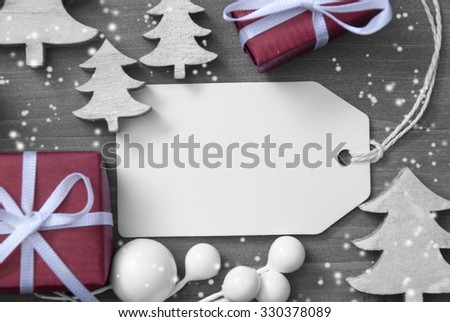 Close Up Of White Label With Ribbon, Christmas Gift Or Present, Ribbon And Christmas Tree With Snowflakes. Christmas Decoration Or Card On Wooden Background. Copy Space Or Free Text For Advertisement. - stock photo