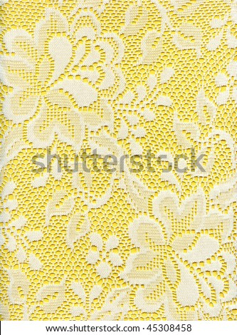 Close Up Of White Lace Floral Fabric On Yellow - stock photo
