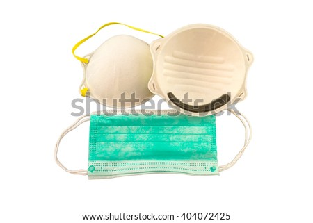 Close up of white mask and blue surgical mask isolated on white   background - stock photo
