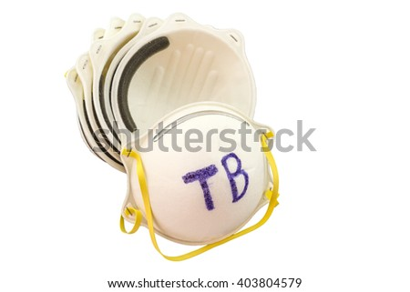 Close up of white mask stack  and word TB in mask on white  background,touch-up in prevention of tuberculosis - stock photo