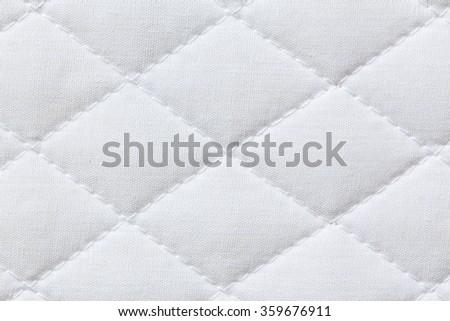 close-up of white mattress bedding pattern background - stock photo