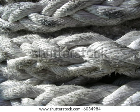 Close-up of white nautical rope on a ship - stock photo