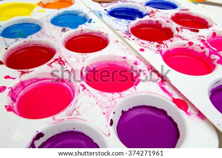Close up of white plastic art palette with watercolor paint - stock photo