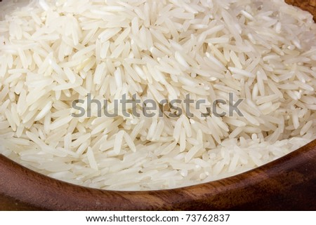 Close-up of white rice in a brown plate. - stock photo