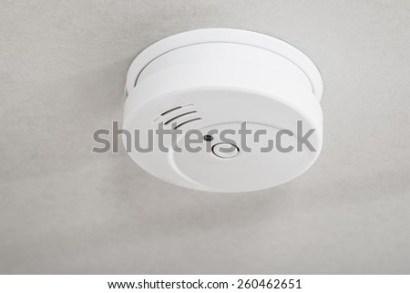 Close-up Of White Smoke Detector On A Ceiling - stock photo