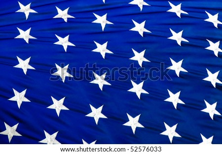 close up of white stars on blue background from the American stars and Stripes flag - stock photo