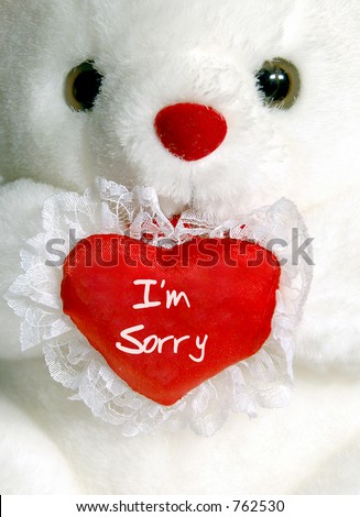"Close-up of white teddy bear with ""I'm Sorry"" heart - stock photo"