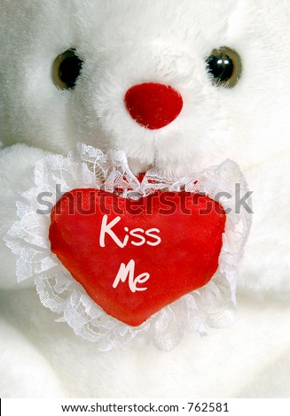 "Close-up of white teddy bear with ""Kiss Me"" heart - stock photo"