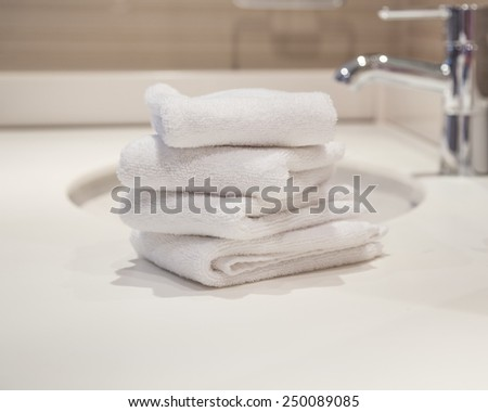 close up of white towels in bathroom (interior) - stock photo