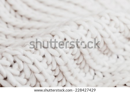 Close up of white wool with detail of woven pattern - stock photo