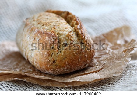 Close up of whole grain brown bread roll - stock photo