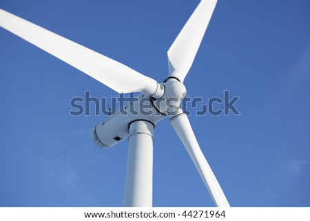 Close up of wind turbine in a windfarm against a clear blue sky