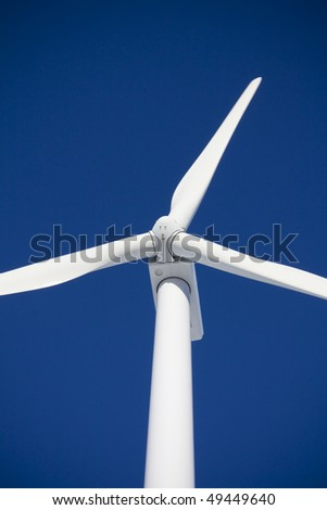 Close up of Wind turbine taken in ontario, against blue sky - stock photo