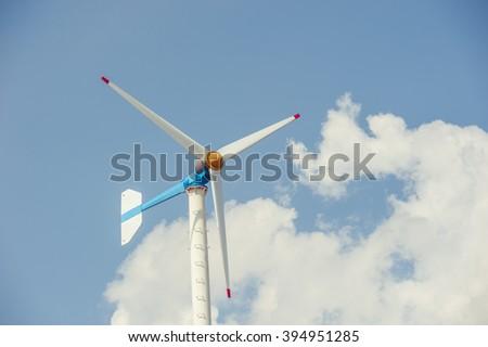 Close up of  wind turbines ,blue sky background - stock photo