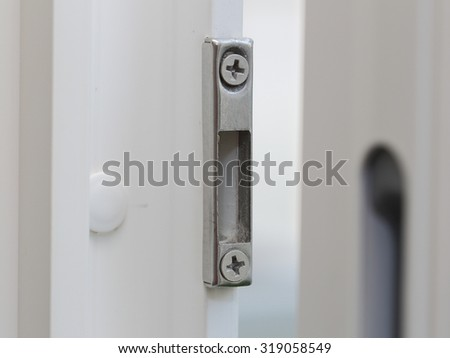 close up of window shutter locking device