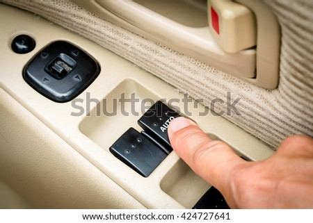 Close up of windows controls and adjustments. Car window controls - stock photo