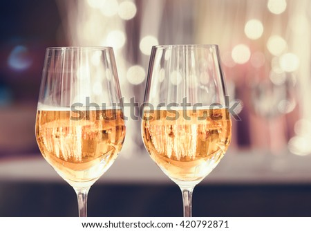 Close up of wine glasses in a bright setting.  - stock photo