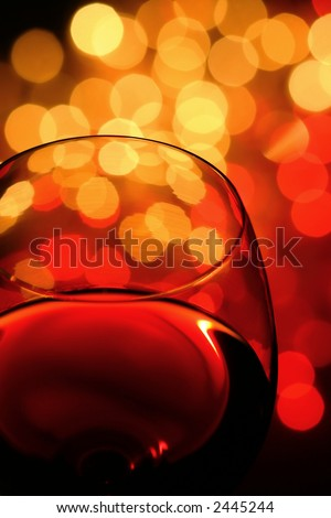 close-up of wineglass with abstract lights background - stock photo