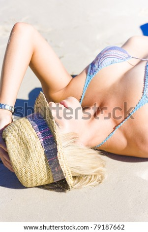 Close-up of with eyes closed on beach - stock photo