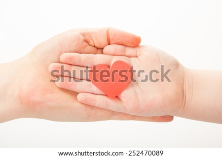 close up of woman and child hands with heart isolated on white background
