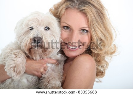 Close-up of woman and her dog. - stock photo