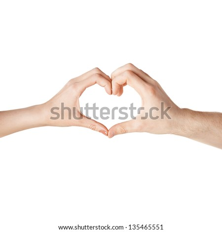 close-up of woman and man hands showing heart shape