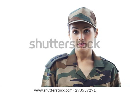 Close-up of woman army soldier against white background - stock photo