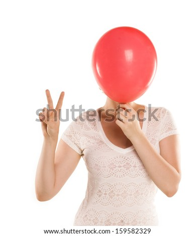 Close up of woman covering her face using rad balloon
