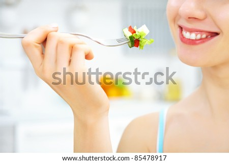 close-up of woman eating fresh salad - stock photo