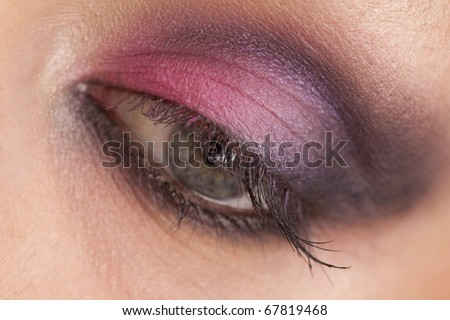 Close-up of woman eye with ceremonial bright make-up