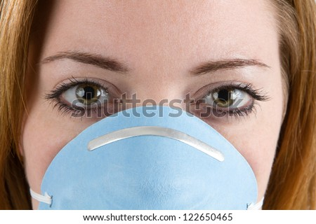 Close up of woman face wearing a filter mask or facemask.