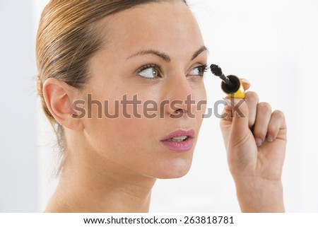 Close up of woman face with mascara brush