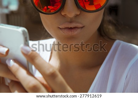 close up of woman face with smart phone. horizontal shot. - stock photo