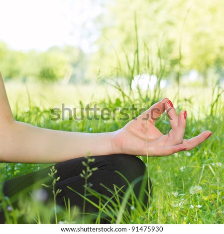 Close up of woman hand during meditation outdoors.