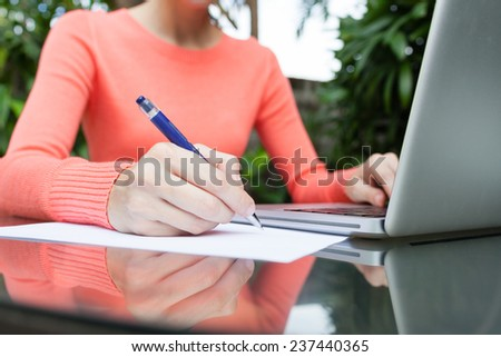 Close up of woman hand writing on paper - stock photo