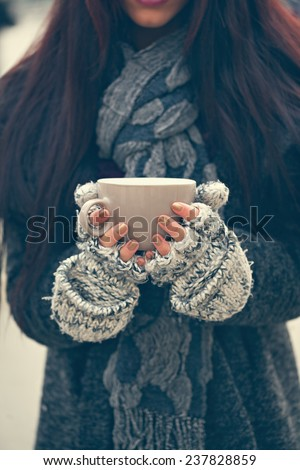 Close Up Of Woman Hands Holding A Mug Of Hot Beverage - stock photo