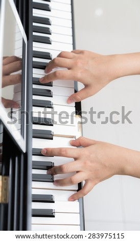 Close up of woman hands  playing piano - stock photo