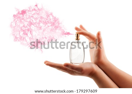 close up of woman hands spraying perfume - stock photo