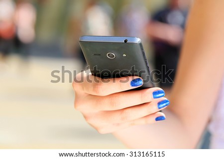 Close up of woman hands using her cell phone and writing text message